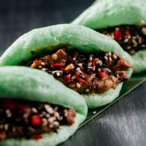 Matcha Bao Bun Pork Belly - Sweet Sesame Sauce - Chilies - Asian Slaw